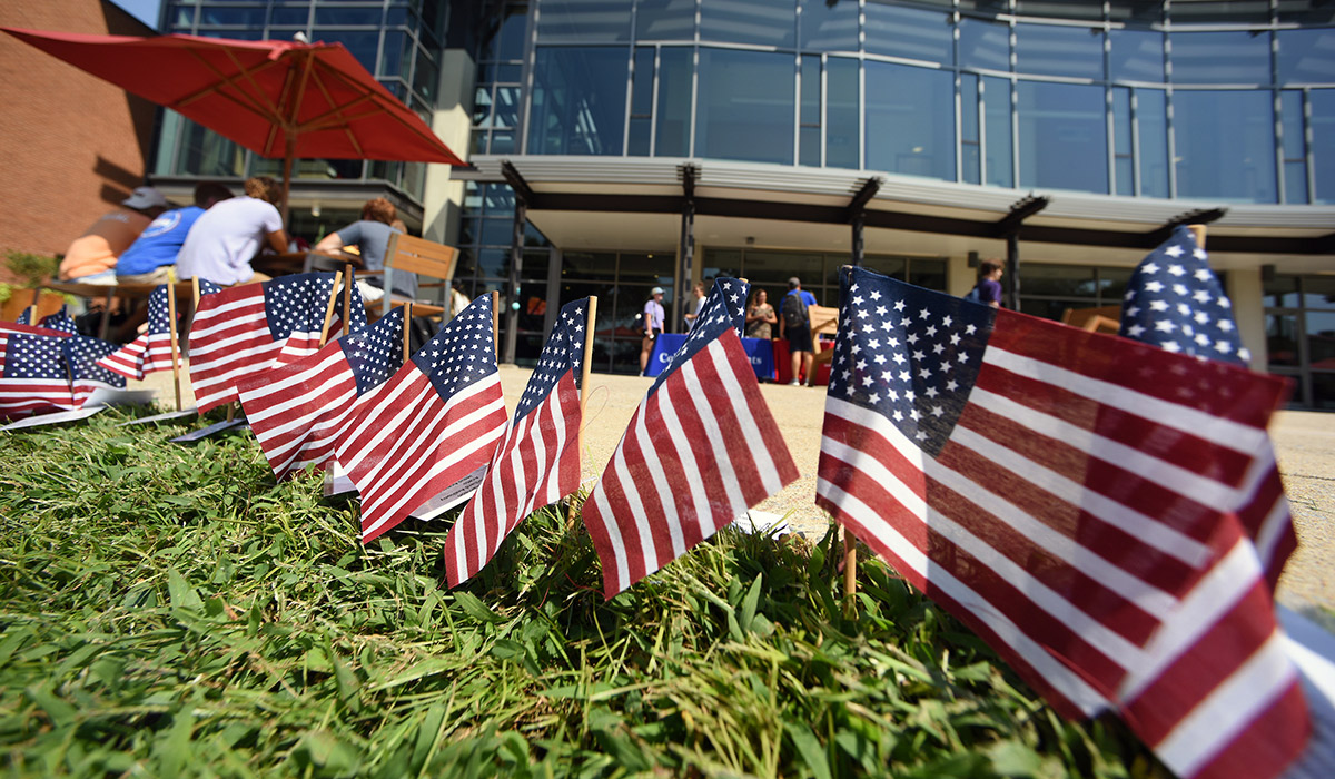 A line of American flags placed in front the the pryz