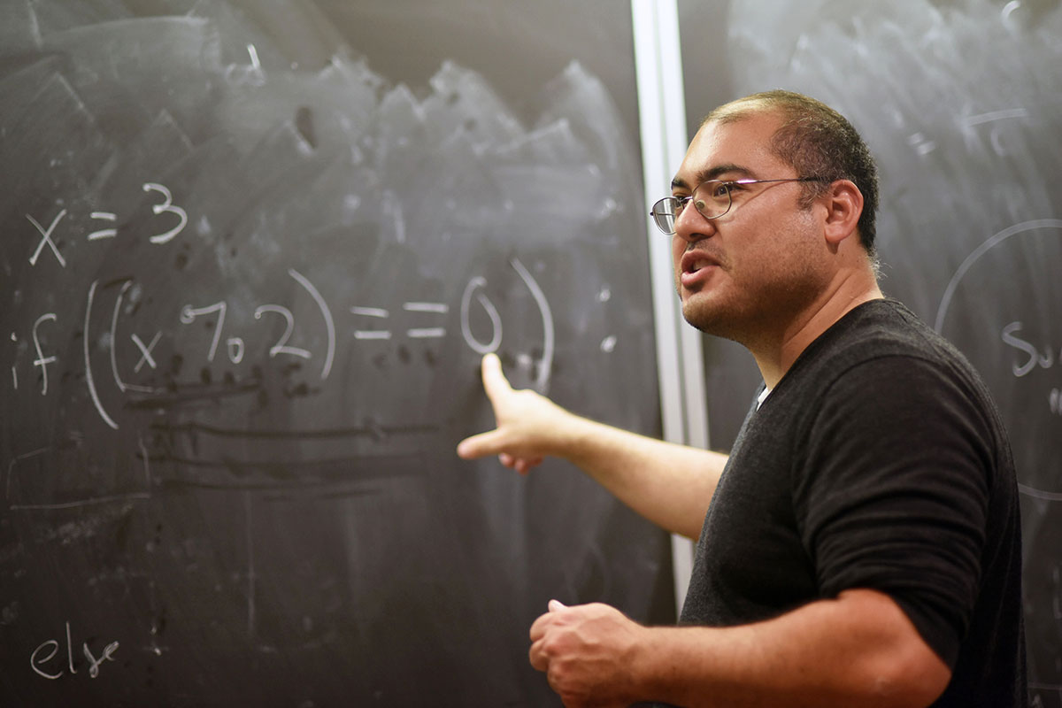Professor of Mathematic Curtis Holliman teaches high school and pre-college students