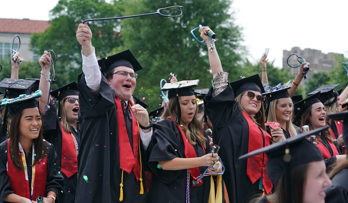 Students celebrating commencement