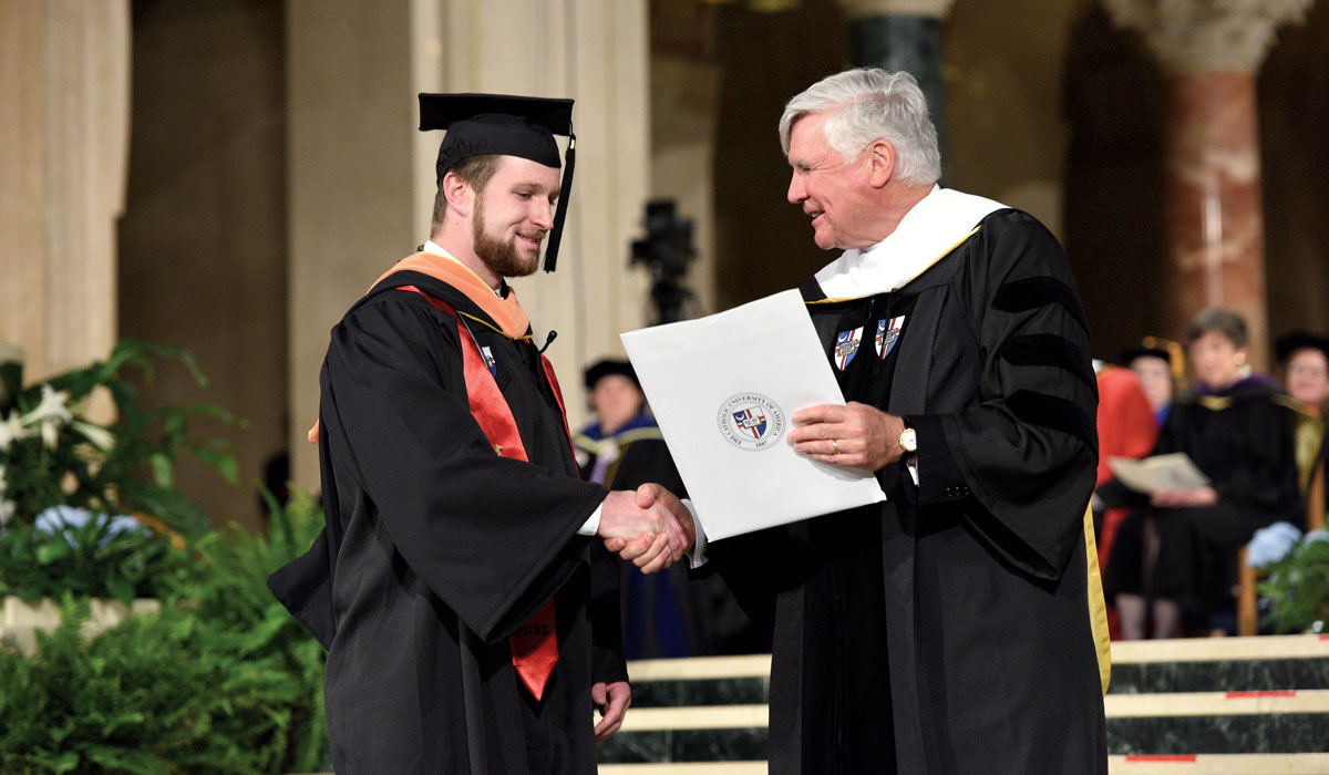 Conway Scholar Greg Daly receives his diploma from Bill Conway at his 2017 graduation.