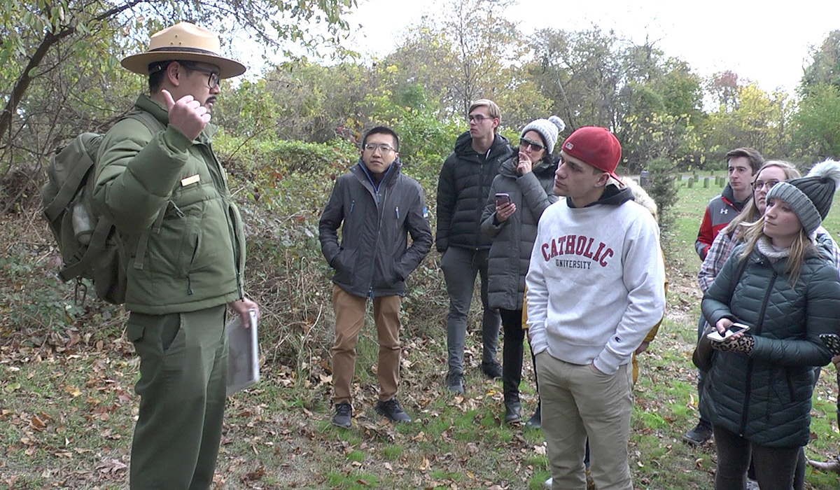 Students listening to park ranger at Fort Totten Park