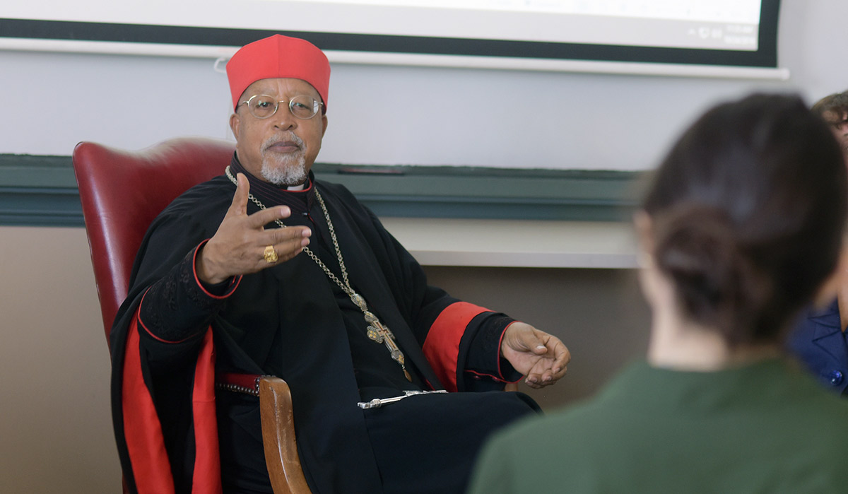 Cardinal speaking to class