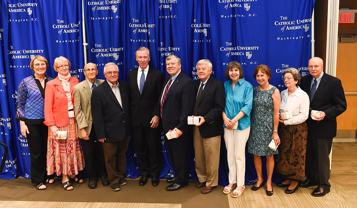 Faculty award recipients standing with President Garvey
