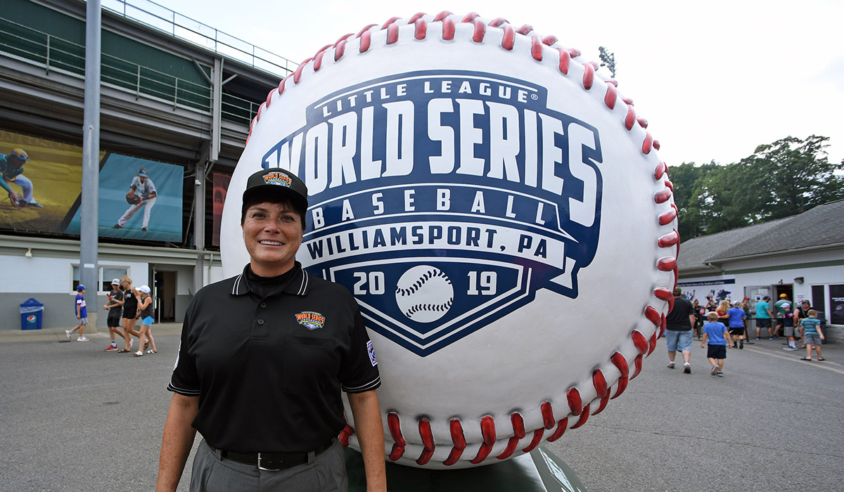 Kelly Dine standing for a photo at the 2019 Little League Baseball World Series.