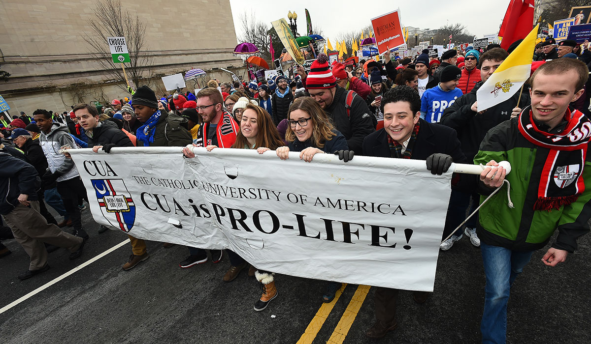 Students carry banner in March for Life