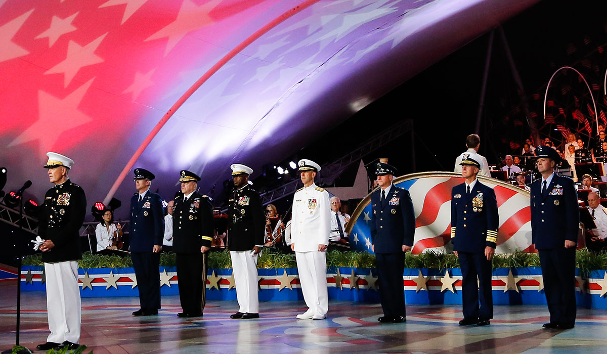 Military service members on stage during the concert