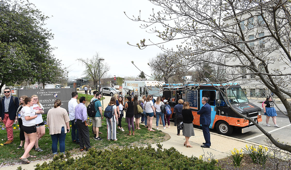 People lined up at food trucks