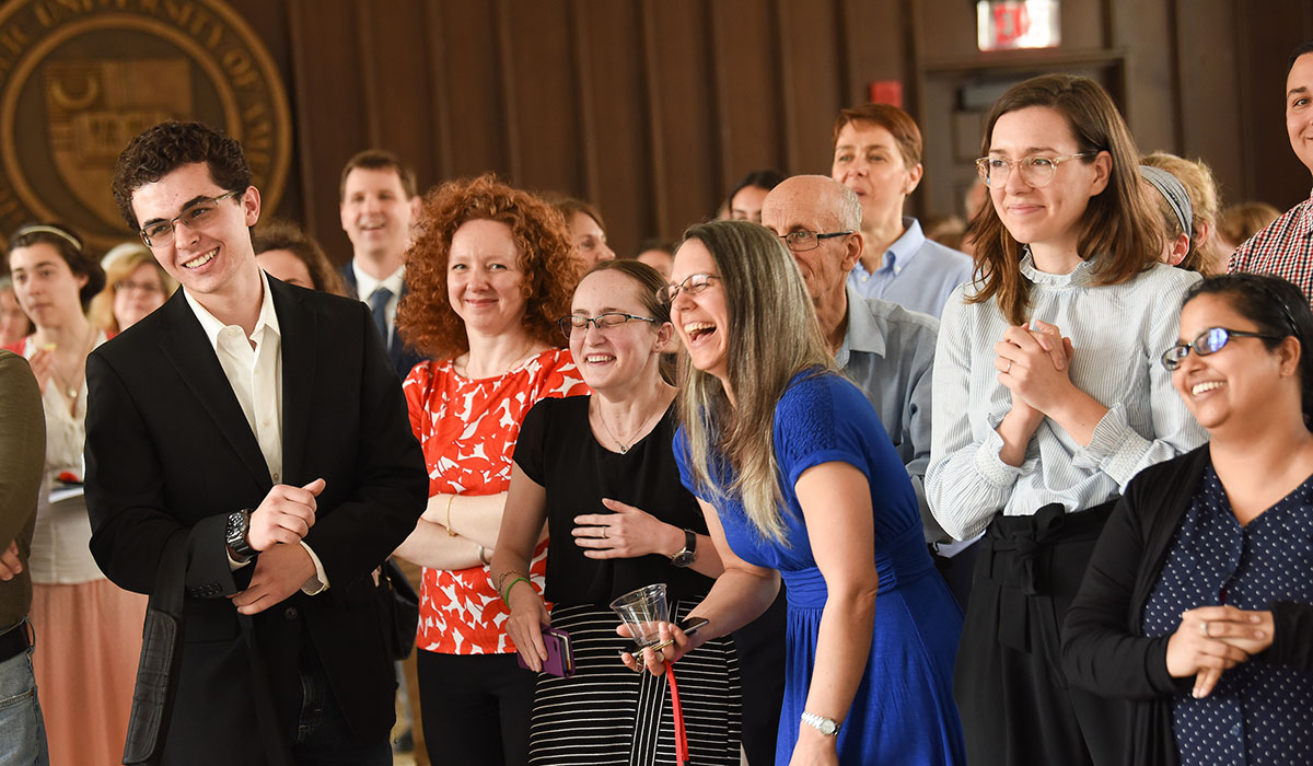 Students and professors laughing at awards ceremony