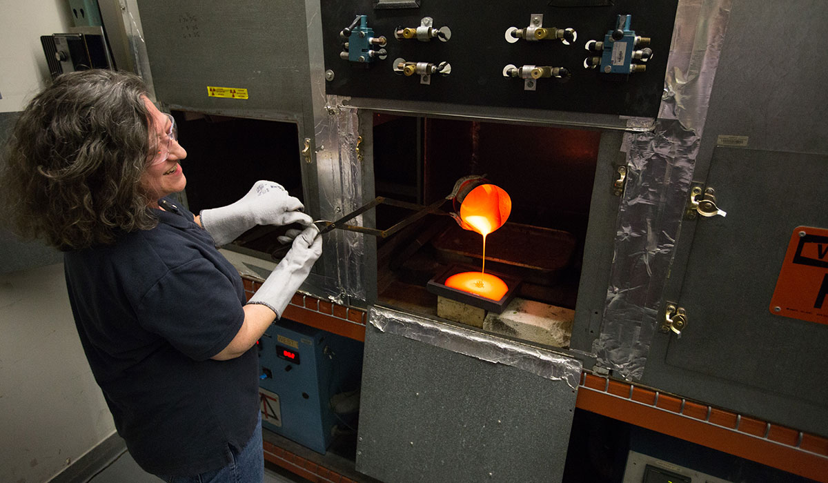 VSL researcher in the lab using fire