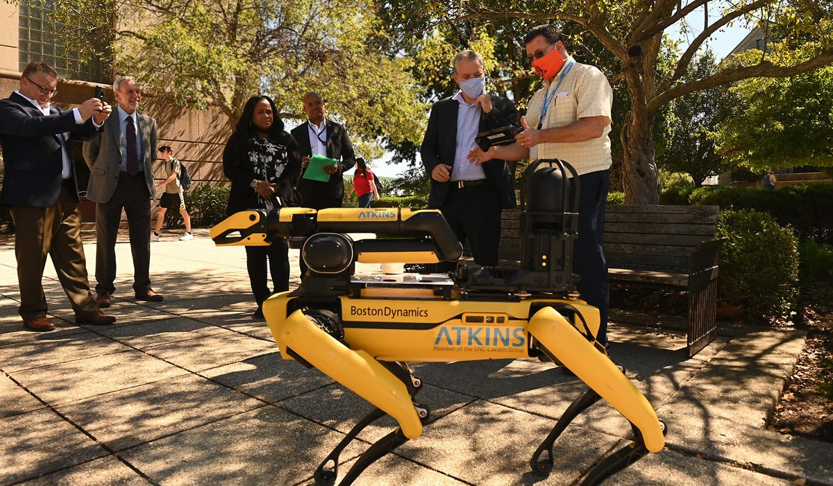 Dept of Energy visitors view robotic dog