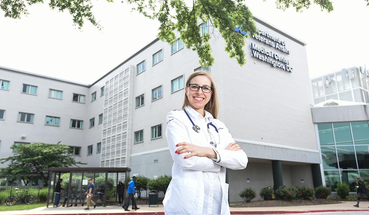 Nurse standing outside hospital