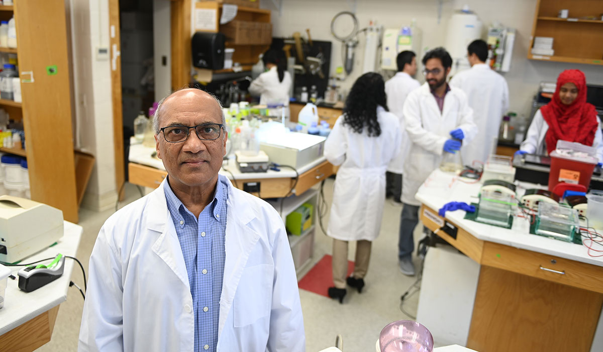 Venigalla Rao in his lab