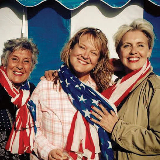 Three women with an American flag dress