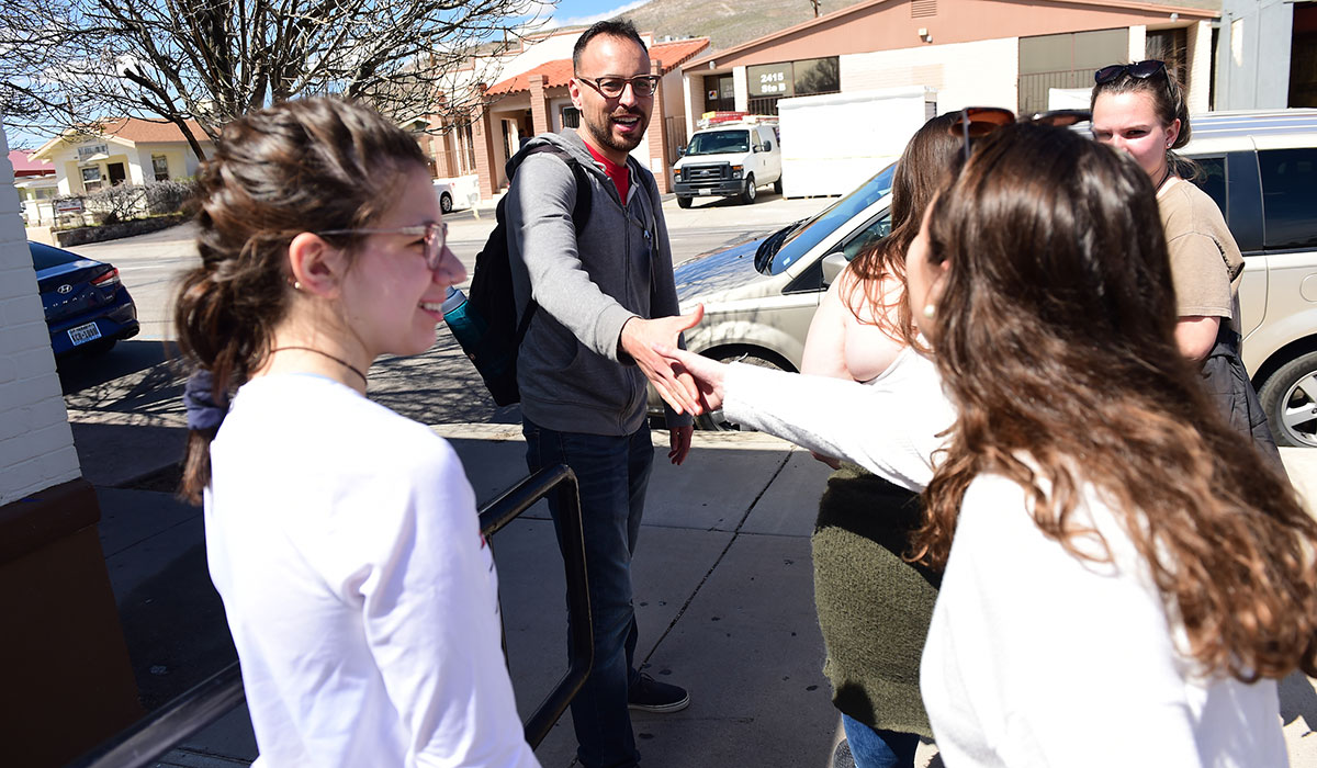 Student shaking hands with person they met on border immersion trip