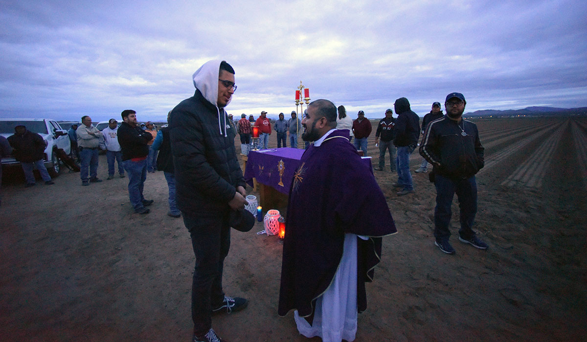 Student talking to priest after sunrise Mass