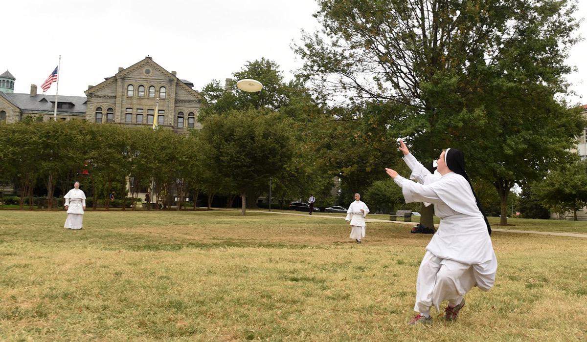 nuns playing frisbee