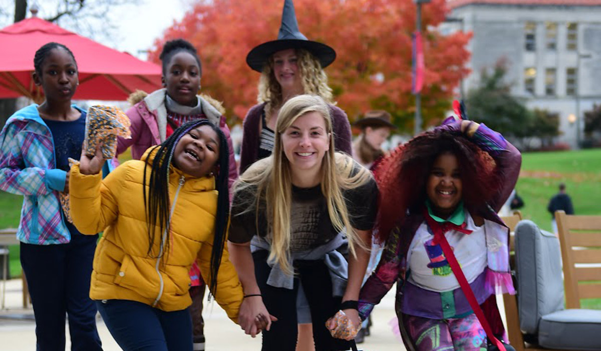 students and children in costumes