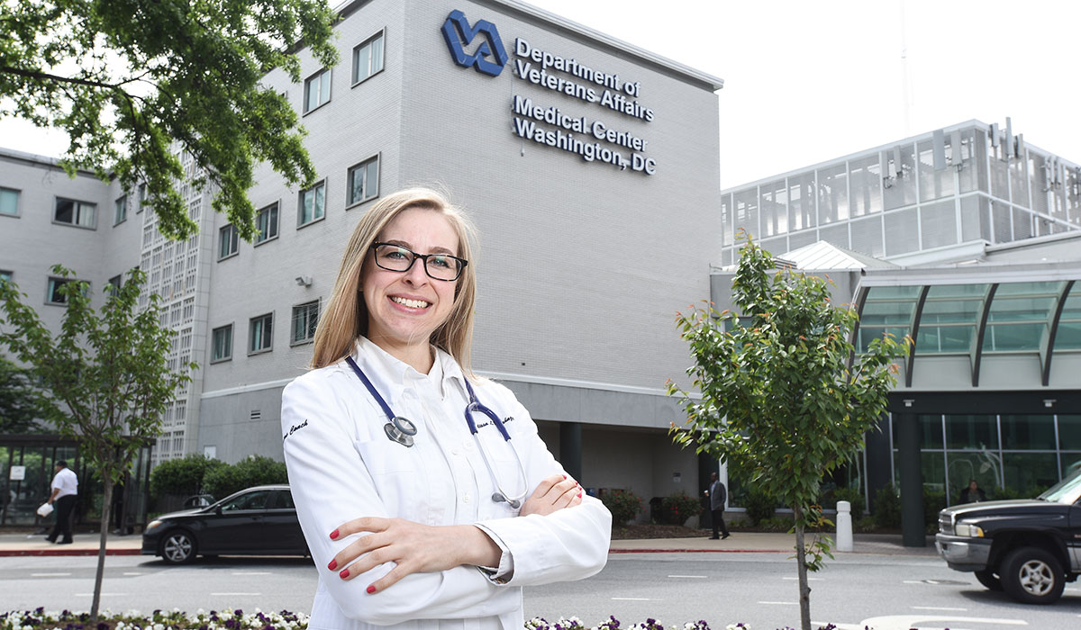 Nursing student in front of Veterans Affairs hospital