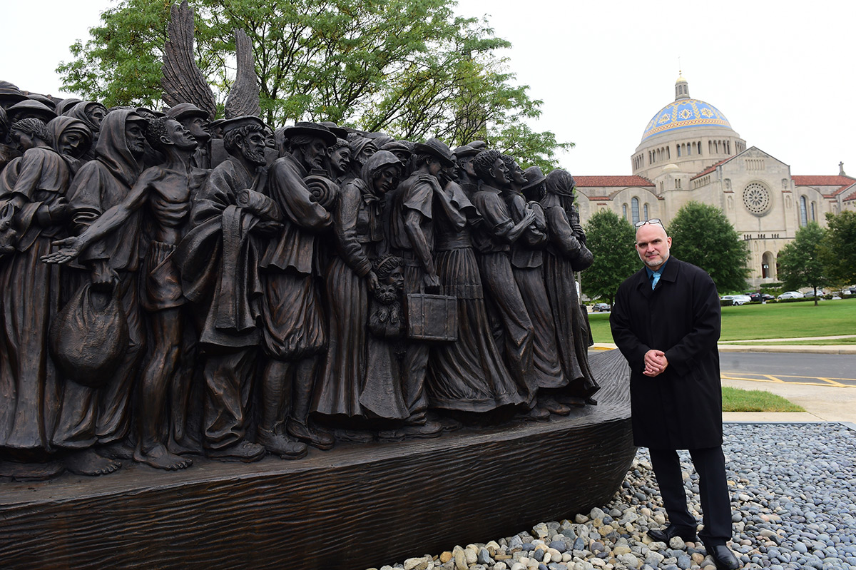 Artist Timothy Schmalz with the Angels Unawares sculpture