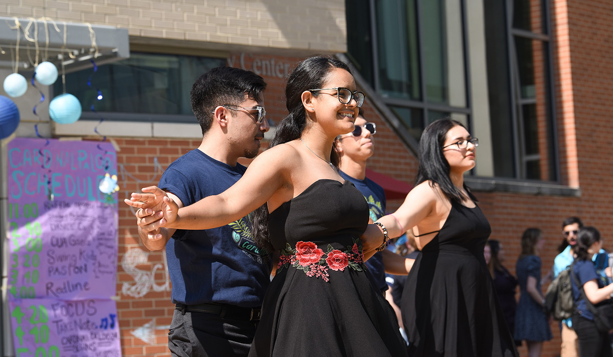Students performing a dance at a campus event