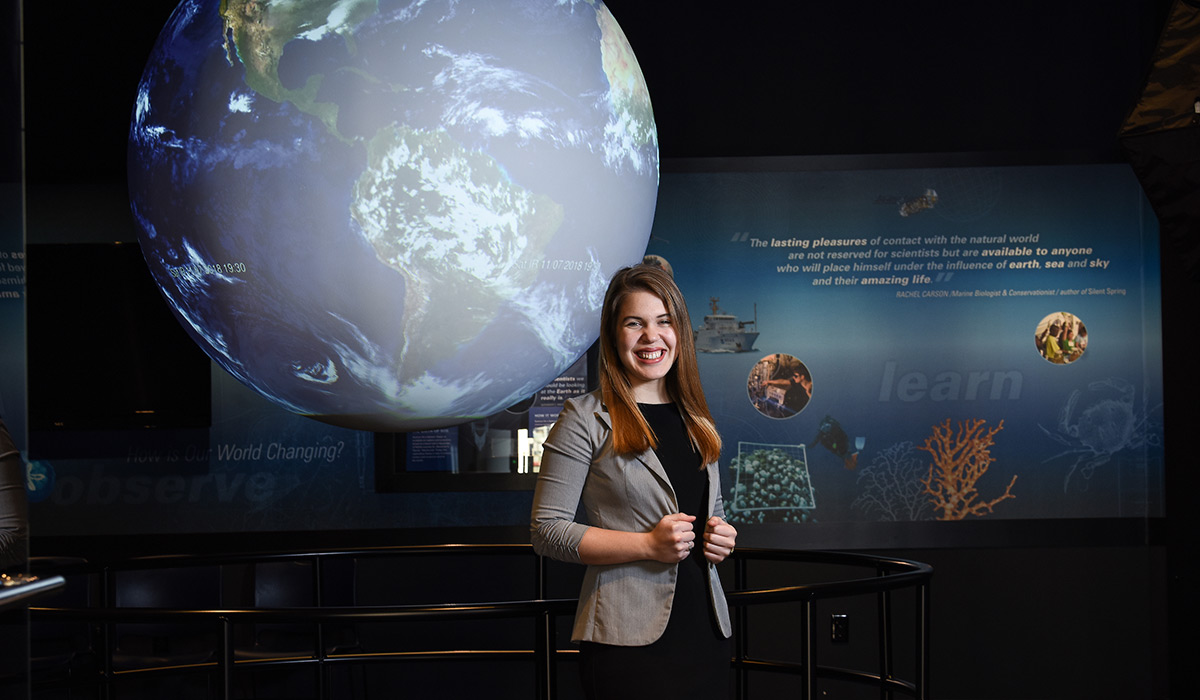 Student in blazer at her internship at NOAA