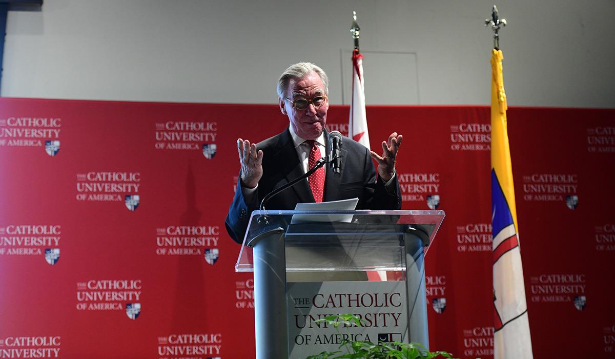 President John Garvey addressing new students