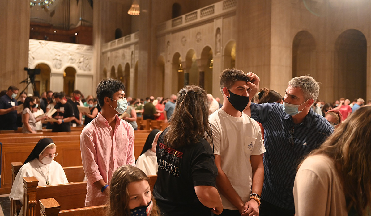 Students and families at Mass
