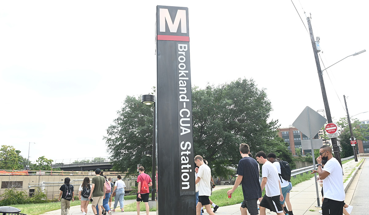 Students walking to Metro stop next to campus
