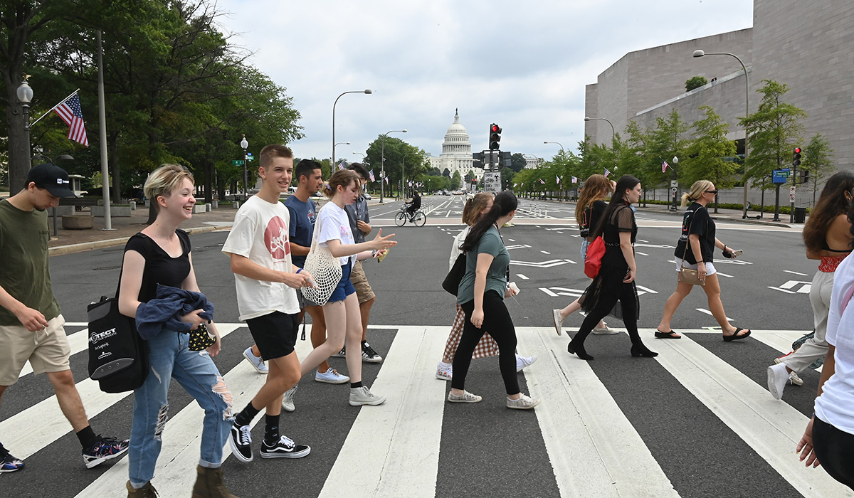 Students crossing a D.C. street with Capitol in the background