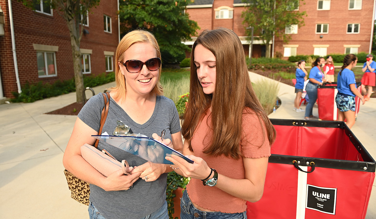 Female student looking at clipboard
